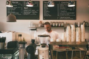 Man Working At A Coffee Shop - Small Business News